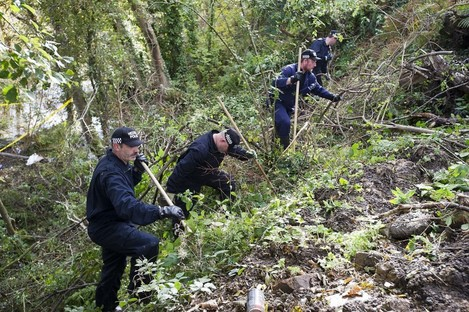 North Wales police officers carrying out a search for missing Catherine Gowing last month (File photo)