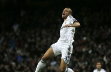 Late Ozil strike earns vital point for Madrid