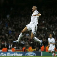 Late Ozil strike earns vital point for Madrid