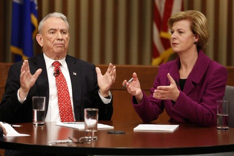 Tammy Baldwin (right) defeated her Republican rival Tommy Thompson (left) in a narrow election.