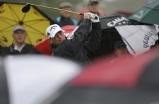 Rain halts McIlroy as Bjorn takes Singapore lead