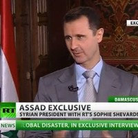 Assad warns against armed intervention