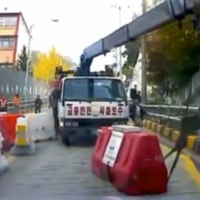 VIDEO: Dodging a runaway truck? No problem for THIS driver