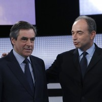 Both candidates to succeed Sarkozy claim win in French party election