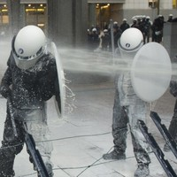 Dairy farmers blast European Parliament and riot police with milk