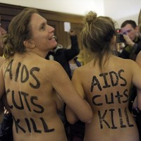 Naked protesters occupy Washington office over possible AIDS cuts