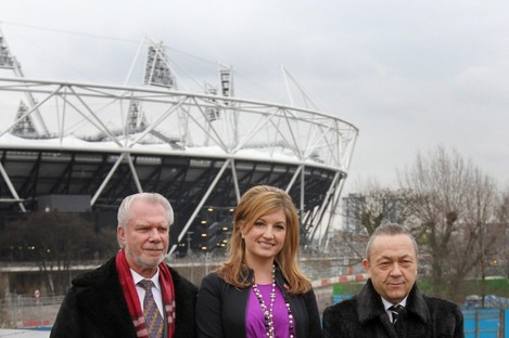 West Ham football club owners David Gold (left) and David Sullivan (right) with vice-chairman Karren Brady posing in front of the Olympic Stadium in London.