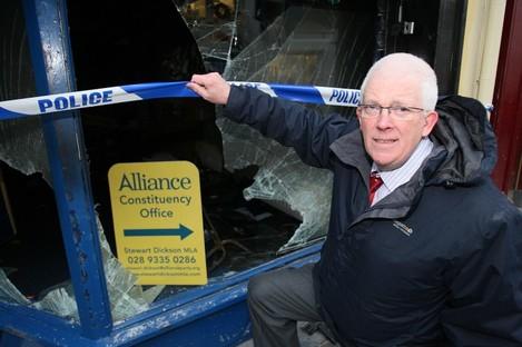 Alliance MLA Stewart Dickson in Carrickfergus, Co Antrim beside his office which was attacked last night.