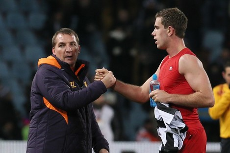Liverpool's coach Brendan Rodgers, left, greets Jordan Henderson at the end of the UEFA Europa League Group A soccer match.