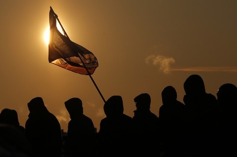 Demonstrators hold a protest rally in St. Petersburg, Russia, Saturday, Dec. 15, 2012