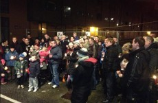 Priory Hall residents hold vigil ahead of second Christmas