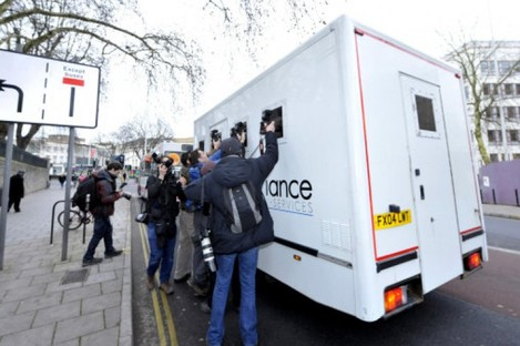 Photographers chase after a van believed to be carrying Dutch engineer Vincent Tabak outside Bristol Magistrates' Court, where he appeared accused of the murder of Joanna Yeates.