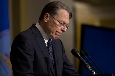 National Rifle Association executive vice president Wayne LaPierre pauses as he makes a statement during a news conference in response to the Connecticut school shooting