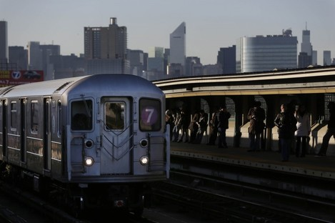 A train passes through the 40th St - Lowery St station in NYC where the man died after being pushed onto the tracks