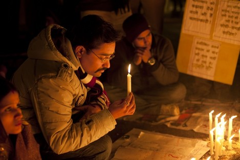 Indians participate in a candle-lit vigil to mourn the death of a gang rape victim in New Delhi, India today.