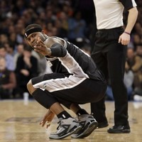 NBA player sprains ankle after tripping on a waitress taking New York mayor's drink order at a Knicks game
