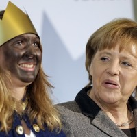 Angela is not that impressed with Germany's carolers