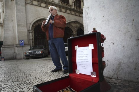 Jose Fonseca, 62, who has been unemployed for six months, plays music on the street for money in downtown Lisbon, earlier today.