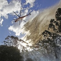 Cooler weather aids Australia firefighters