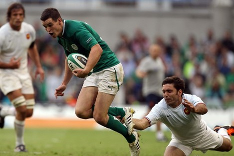 Jonathan Sexton is tackled by France's Dimitri Yachvilli.
