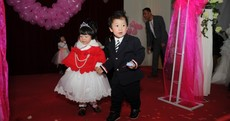 Photos: Hundreds of kids take part in 'group wedding'