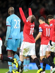 Returning Rooney hammers Manchester United into FA Cup fourth round