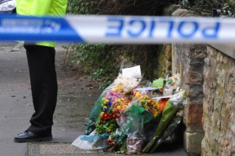 Police guard the entrance to Joanna Yeates's flat in Bristol.