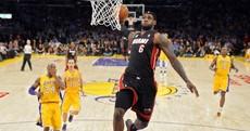 A perfectly-timed photo of LeBron James dunking on the Lakers last night
