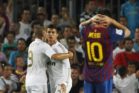 Leo Messi reacts to a Cristiano Ronaldo goal.