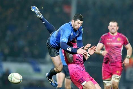 Rob Kearney leaps over Exeter's Luke Arscott.