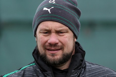 Ireland scrum coach Greg Feek checks out TheScore app during a break in training this week. We think.