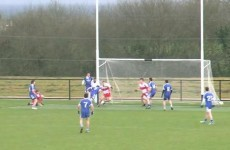 GAA player scores a header in today's Ballinderry-Donagh clash