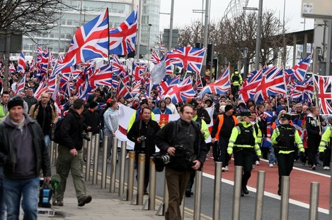 Loyalist Protestors converge on Belfast city hall earlier this month.