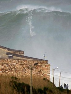 Surfer breaks world record by riding enormous 100-foot wave
