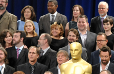 Who is the woman wearing cat ears in the Oscar Nominees photograph?