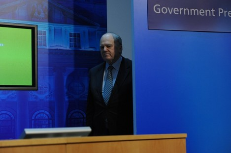 Minister for Finance Michael Noonan enters a press conference on the day the promissory note deal was announced