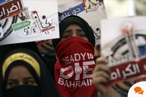 Anti-government protestors marching in Sanabis, Bahrain on Monday, two years after the uprising began.