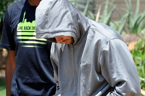 Pistorius leaves the Boschkop police station, east of Pretoria, yesterday afternoon.