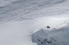 VIDEO: Skier does backflip despite being chased by an avalanche he caused