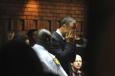 Athlete Oscar Pistorius weeps in court in Pretoria, South Africa, yesterday.
