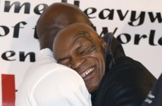 You have to see this photo of Mike Tyson giving Evander Holyfield a giant bear hug