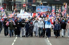 Three people charged following loyalist flag protest
