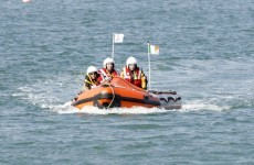 Coast Guard rescues kayaker clinging to boat