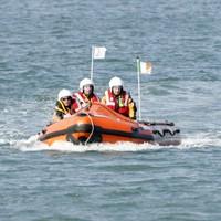Coast Guard rescues kayaker clinging to boat