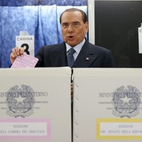 Italy: Topless protesters hurl themselves at Berlusconi