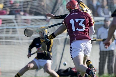 Niall Healy fires home a goal for Galway.