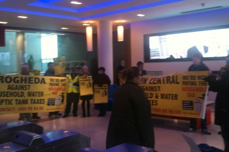 CAHWT protesting in PWC's lobby this afternoon.