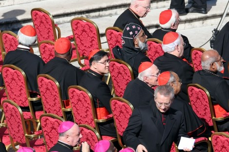 Cardinal Luis Antonio Tagle of the Philippines, centre, sits amongst other cardinals as they attend Pope Benedict XVI's last general audience.
