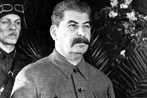 Stalin, with the Spassko tower of the Kremlin in the background right, in Moscow in 1936.