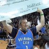 High-school teacher hits half-court shot at NBA game, wins $20,000 to pay for wife's cancer treatment